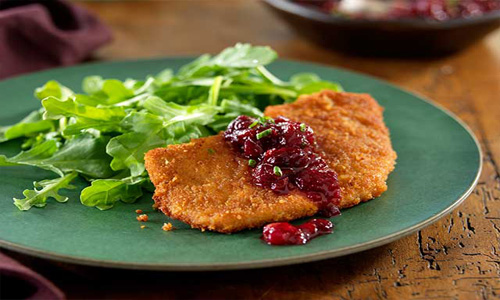 Ginger Crusted Pork Cutlets With Cinnamon Orange Cranberry Chutney And Wilted Arugula